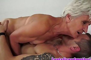 Alluring granny enjoys riding hard cock